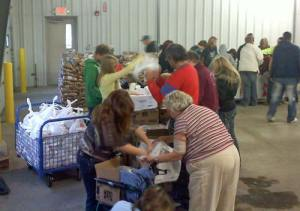 Volunteers unpack delivered food for needy