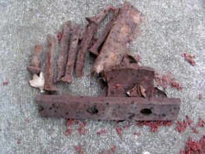 Rusty railroad spikes and plates for tieing rails together