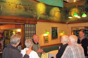 A.J. Dherty, son of the founder, talks about the painting of the laprechauns during a Depression Era art tour in 2012.